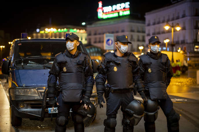Spanish police officers block access to Puerta Del Sol square in Madrid during a protest against the curfew on October 31.