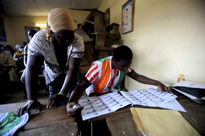Ivorians vote for the presidential election in Abidjan on October 31.