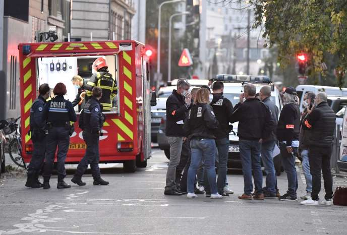 Investigators present in front of the Greek Orthodox Church in Lyon, where the attack on a priest took place, Saturday, October 31.