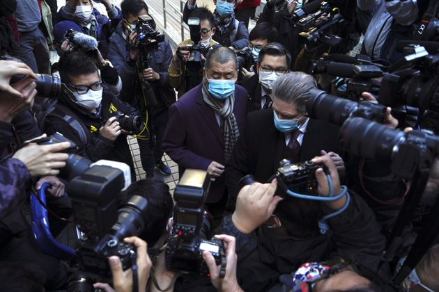 Jimmy Lai (center) is accused of collusion under the new Security Act ...
